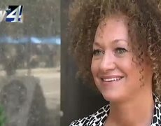 Rachel Dolezal walks out of an interview after the man asks her about his father