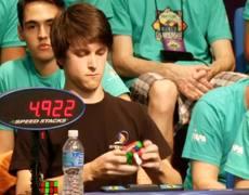 Guy solves Rubik's Cube in under 6 seconds