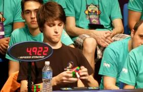 Guy solves Rubik's Cube in under 6 seconds