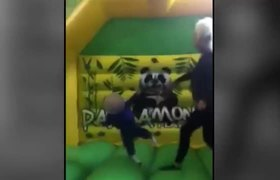 VIDEO: Courtney Stewart throwing Down's syndrome son around bouncy castle