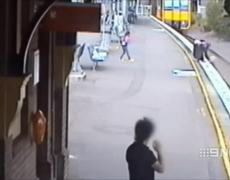CCTV: Girl almost being run over by a train in Sydney