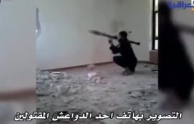 #StupidPeople - #ISIS fighter tries to fire RPG through a small hole in a wall