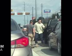 Traffic stop in the middle of street fight