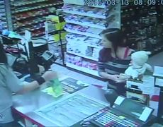 Raw - Clerk Grabs Baby from Woman Before She Collapses