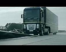 Epic Truck jumps a racecar