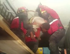 Raw - Man found stuck in ceiling during Ecuador Earthquake rescue effort