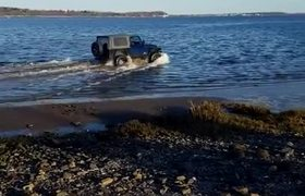 Drunk Driver Gets His Jeep Stuck In The Mud At The Beach