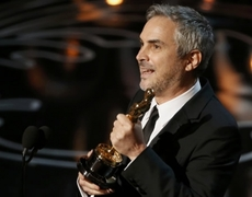 Alfonso Cuarón receives Oscar for Best Director Gravity