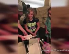 Girl gets excited when receiving a doll with prosthesis