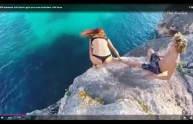#VIRAL - Scary moment hot bikini girl survives botched cliff dive