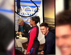 Zac Efron Surprises Simone Biles With a Kiss