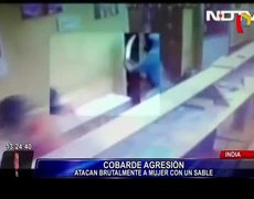 #CCTV - Man with axe attacks woman in India
