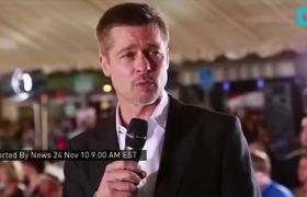 Brad Pitt interactua con sus fanaticas en el estreno de Allied