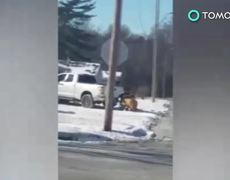 VIDEO - Kansas pastor films obese woman in wheelchair towed by pickup truck