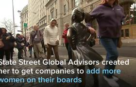 'Fearless Girl' Statue Faces Off Against Wall Street Bull