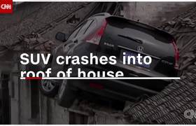 Raw video - See out-of-control SUV crash onto house's roof