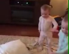 Babies imitating a Frozen scene