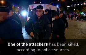 Police officer shot dead in central Paris