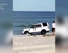 #VIRAL: SUV sinks into beach in photoshoot gone wrong