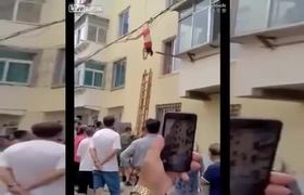 #VIDEO: Mistress hangs upside down on utility cables