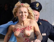 FEMEN activist protest topless in the St Peters Square