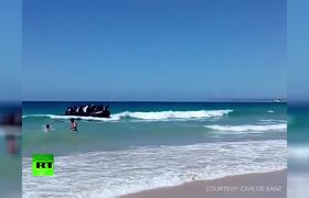 Spanish tourists shocked as dinghy full of migrants lands on shore