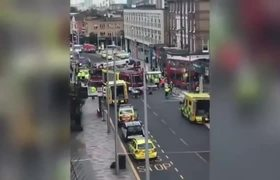 London double-decker bus crashes into building