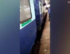 Woman escapes after falling into the gap next to a moving train