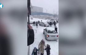 Van Hits Multiple Cars Sliding Down Icy Road