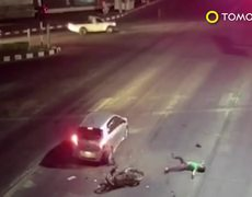 CCTV footage shows motorcycle up close and personal with a stopped automobile