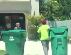 Grandmother Gives Cold Drinks to Garbage Men
