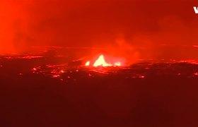 Lava from Hawaii's erupting Kilauea volcano lit up the night