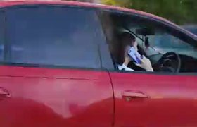 Driver Laughs When Caught on Her Phone