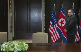 Trump and Kim hold surprise document signing during summit