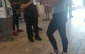 Woman spits McDonald's employee and starts the fight