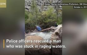 Police officers rescue trapped driver in a rapid river in southwest China