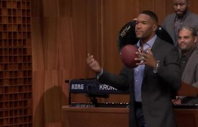 Jimmy Goes Long for a Michael Strahan Football Toss