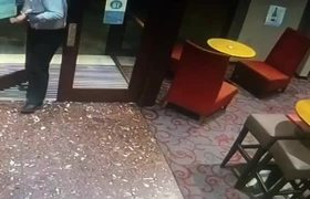 Man Frantically Tries to Save Phone From Falling to Floor