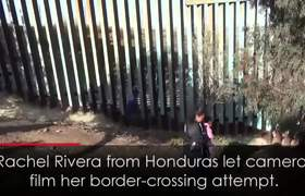 Mother and daughter crawl under US-Mexico border fence