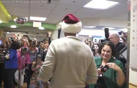 #BarackObama Delivers Holiday Gifts Wearing Santa Hat At Children's Hospital