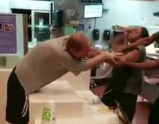 Costumer and employee of McDonald's fight wildly for a straw
