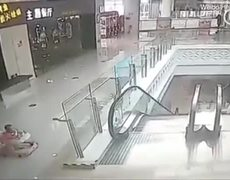 #VIRAL: Shocking moment baby falls down escalator in Chinese mall