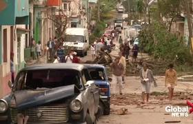 Residents survey damage after rare twister rips through Havana