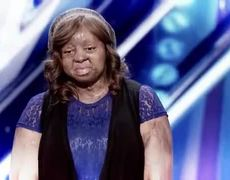 America's Got Talent: The Champions : Kechi: Singer Gets Emotional Golden Buzzer From Simon Cowell