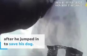 Police use leash to rescue man trying to save his dog on icy Lake #Michigan
