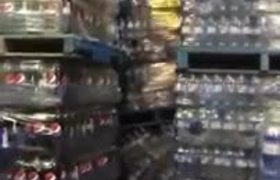 Huge Towers of Soda Cans Fall Over