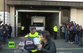 Julian Assange leaves the court of Westminster in a police van