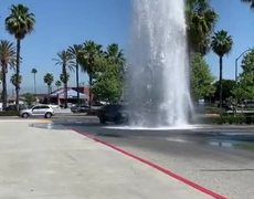 Cars Using Broken Fire Hydrant as Free Car Wash