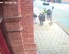 Shocking moment groggy cyclist stumbles into moving bus after falling off bike