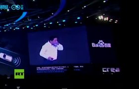 Stage intruder 'refreshes' CEO of Chinese search giant Baidu at an event in Beijing